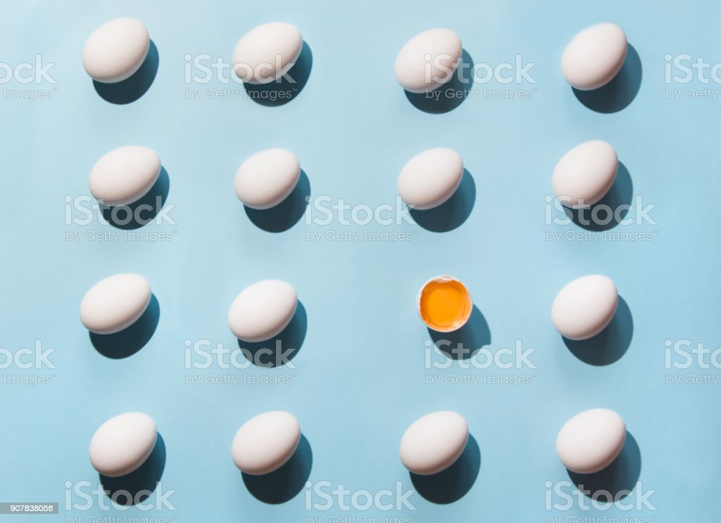 Organic white eggs on blue. Abstract pattern. Eggs in isometric.