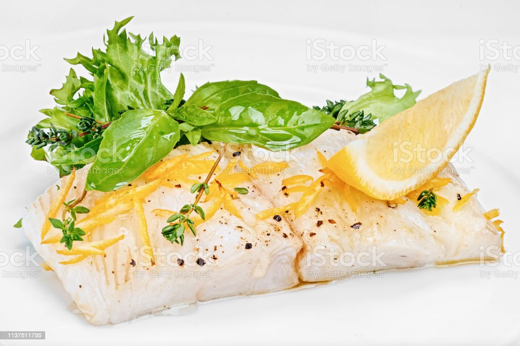 Organic White Fish Fillet Cooked With Fresh Green Salad Leafs And Lemon Stock Photo Download Image Now Istock
