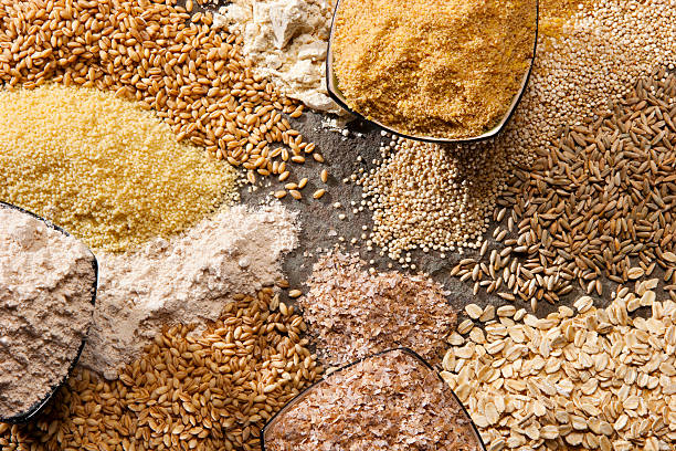 Organic Whole Grains Piles of organic whole grains in different forms. cereal stock pictures, royalty-free photos & images