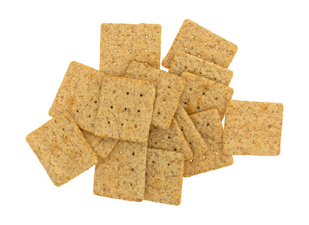 Organic whole wheat crackers isolated on a white background stock photo