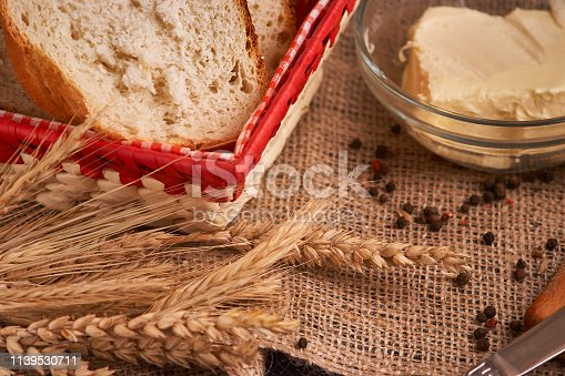 istock Organic Whole wheat lying on bread on black background with copy space. Selective focus 1139530711