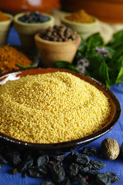 organic yellow couscous and different spices in traditional east - griechischer couscous salat stock-fotos und bilder