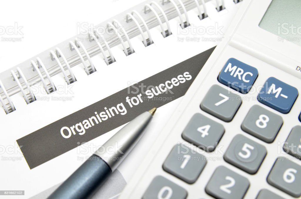 Organising for success printed on book stock photo