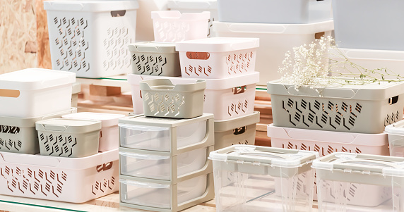 Organization of home space, storage and coziness, a lot of plastic household goods, new clean container boxes with a lid for easy storage of things