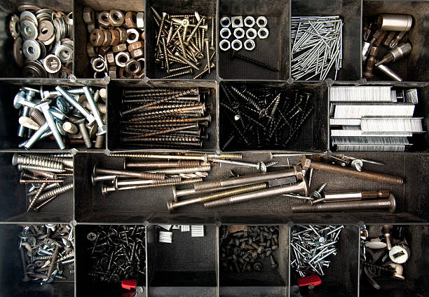 Organized nails, bolts and screws Objects; Organized nails, bolts and screws washer fastener stock pictures, royalty-free photos & images
