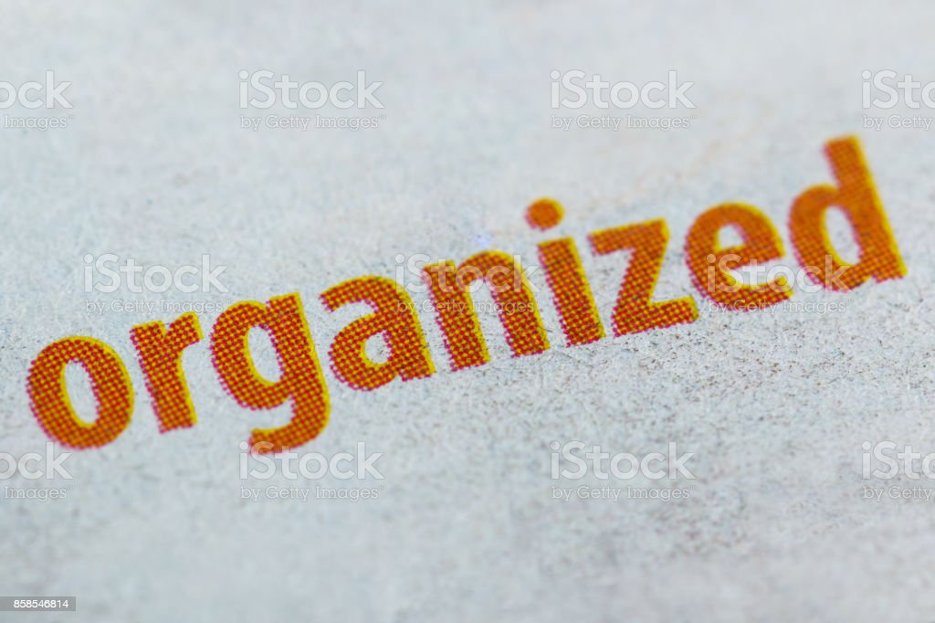 Organized word on paper background stock photo