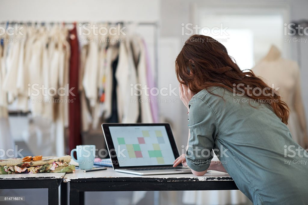 Organizing her tasks for the day with technology stock photo