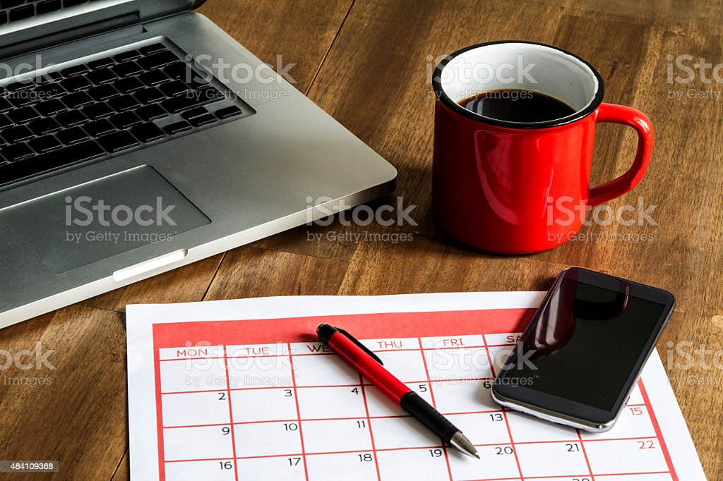 Organizing monthly activities in the calendar stock photo