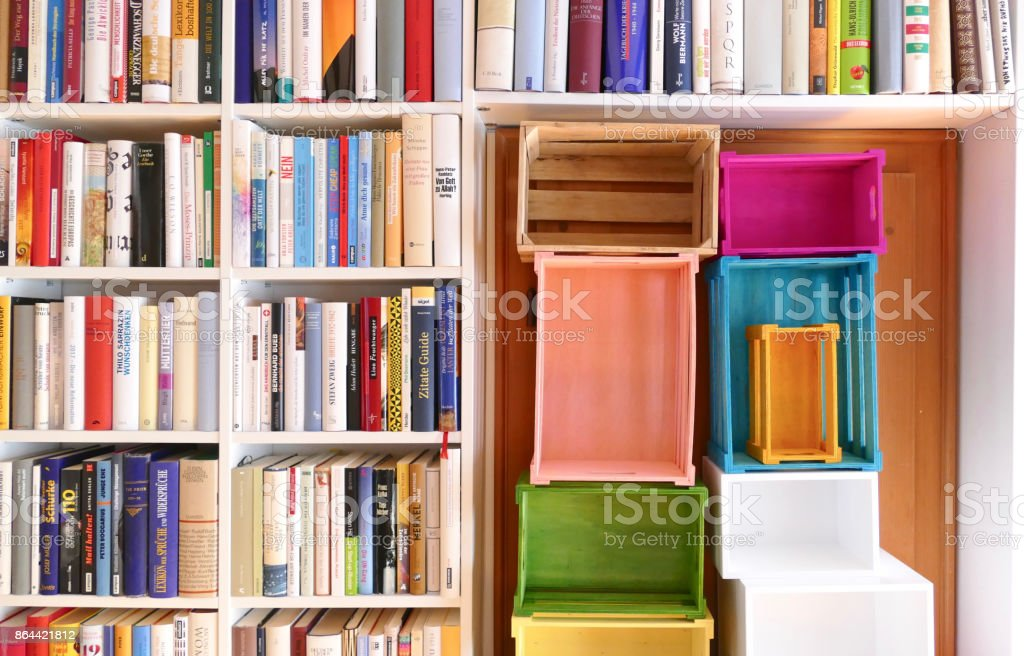 Organizing the Ibrary: full and empty shelves stock photo