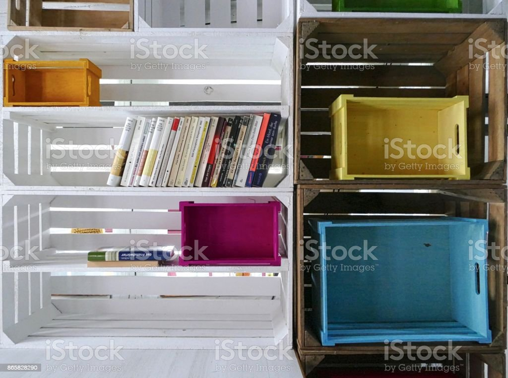Organizing the Ibrary: partly filled wooden shelves stock photo