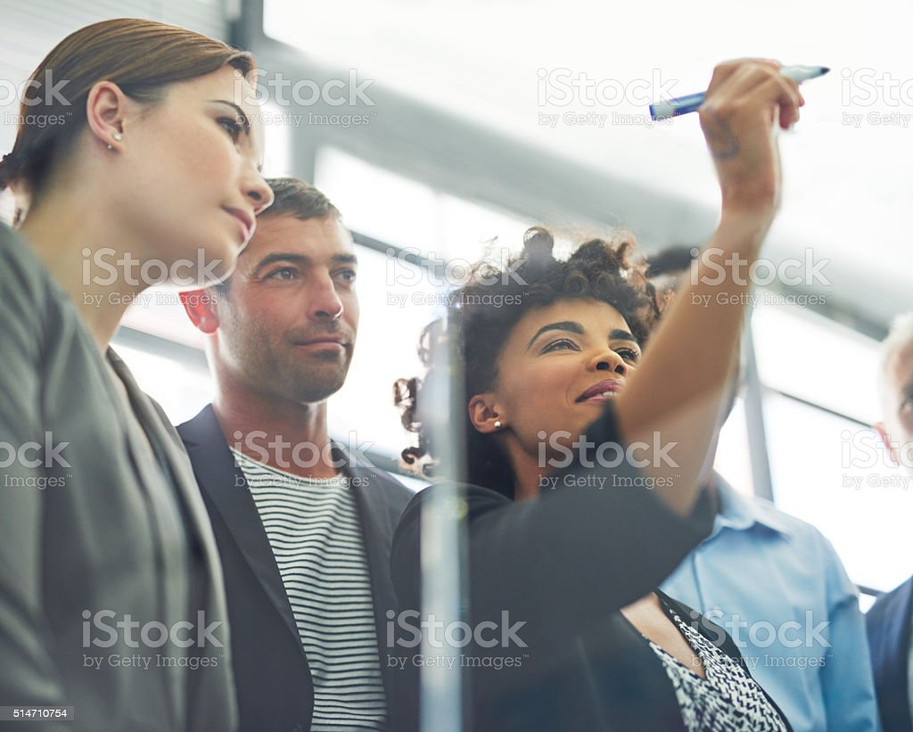 Organizing their ideas into a practical project stock photo