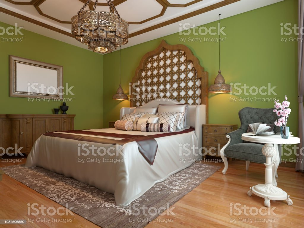 Oriental bedroom in Arab style, with a wooden headboard and green...