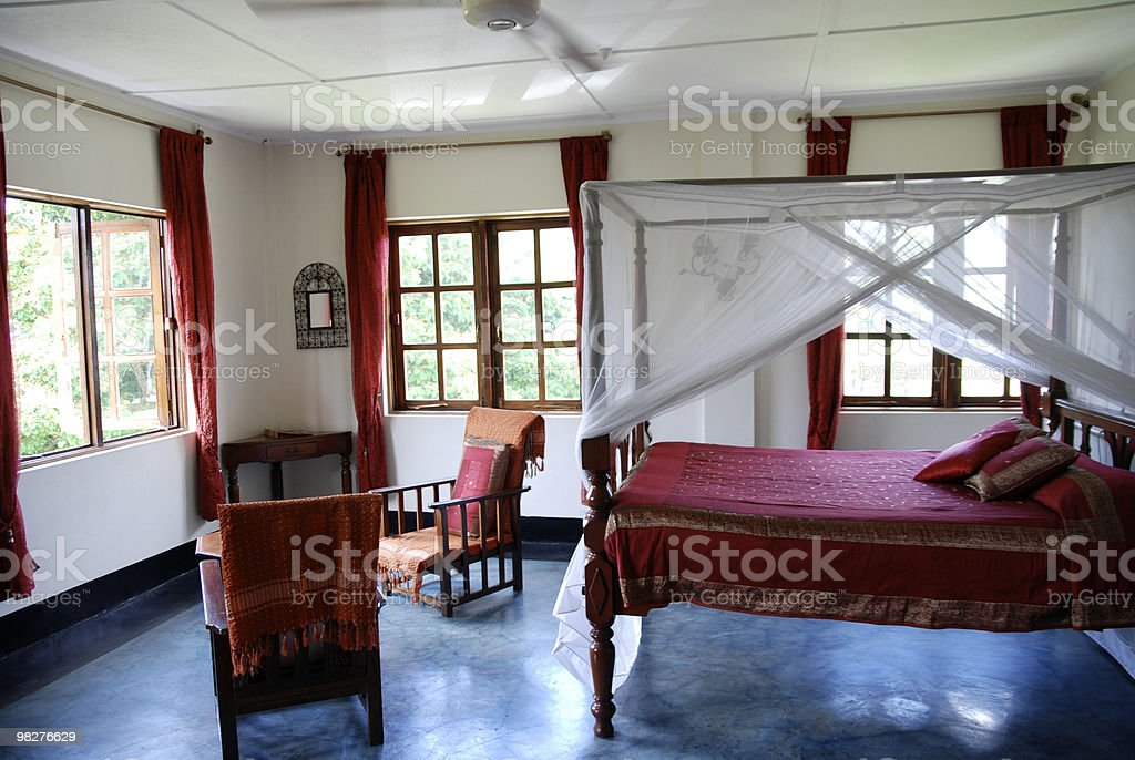 oriental bedroom with canopy bed royalty-free stock photo