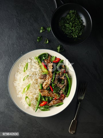 Home made freshness Oriental beef stir fry with bok choy,broccoli,and red chilli  with basmati rice