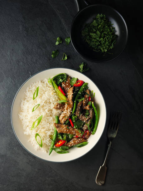 Oriental beef stir fry with basmati rice Home made freshness Oriental beef stir fry with bok choy,broccoli,and red chilli  with basmati rice basmati rice stock pictures, royalty-free photos & images