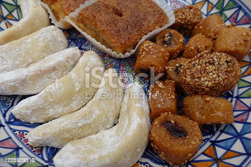 1152965481 istock photo Oriental cakes Ramadan Makroud Kalb el rent Gazelle horn 1225929310