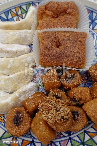 1152965481 istock photo Oriental cakes Ramadan Makroud Kalb el rent Gazelle horn 1225929311