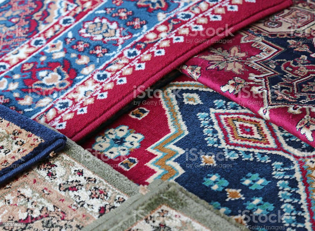 oriental carpets for sale in the shop of rugs stock photo