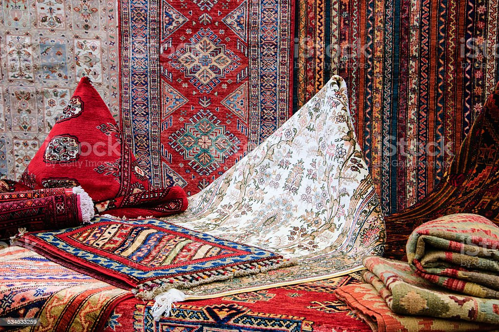 Oriental carpets in the market. stock photo