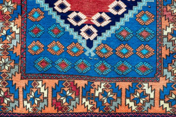 Oriental handmade woolen carpet background stock photo