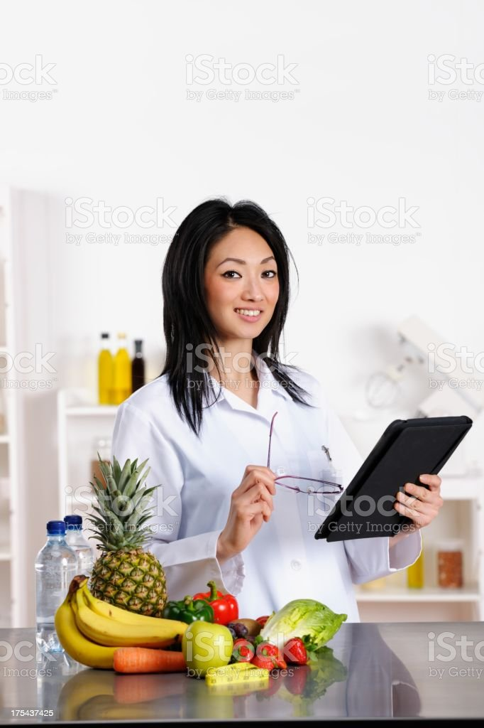 Oriental Healthcare Professional Using Digital Tablet stock photo
