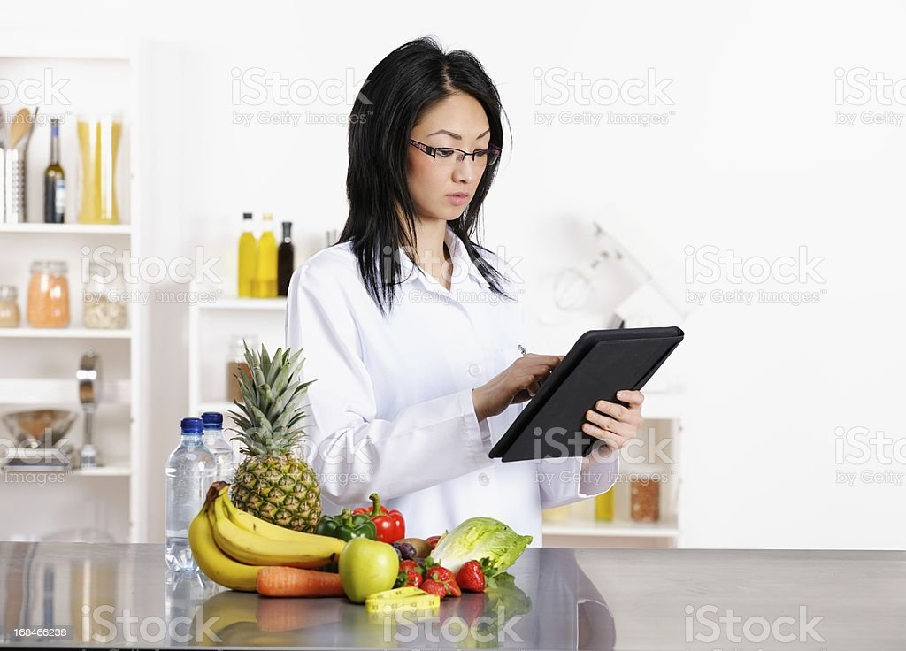 Oriental Healthcare Professional Using Tablet PC stock photo