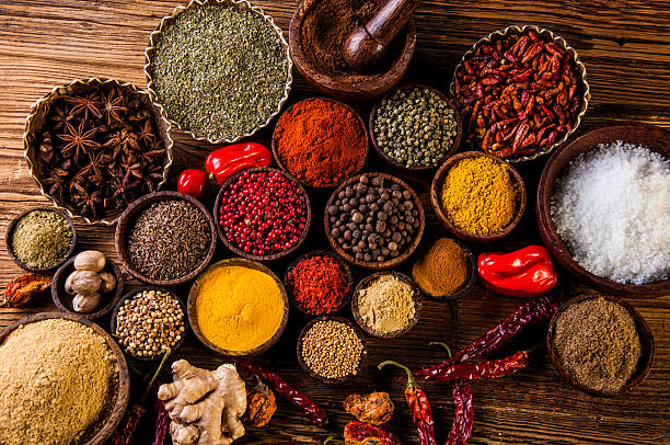 Oriental hot spices on wooden table stock photo