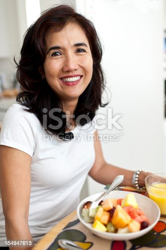 istock Oriental Housewife Having Fruit for Breakfast 154947613