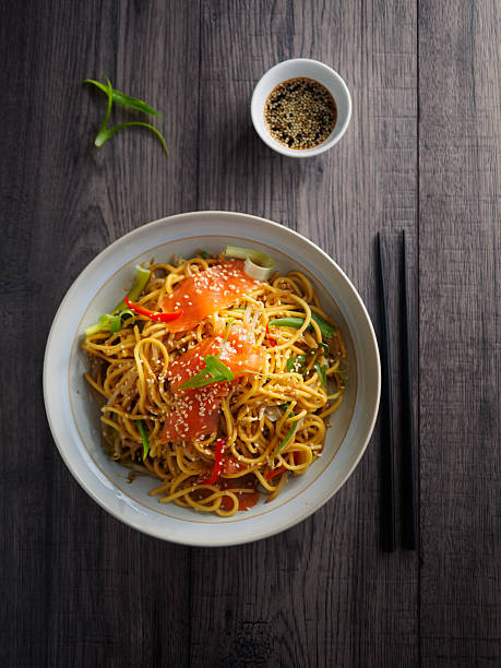 oriental noodles salad with smoke salmon - chinese food stock photos and pictures