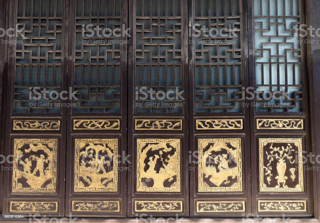 Oriental old Chinese wooden carved door with traditional pattern at an ancient. stock photo