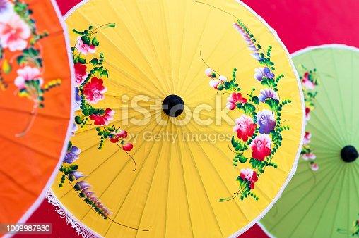 istock Oriental paper umbrellas of various colors. 1009987930