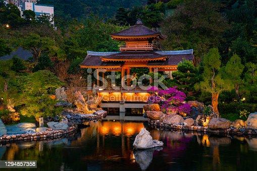 Oriental pavilion and pond in Nan Lian garden, Diamond Hill, Kowloon, Hong Kong
