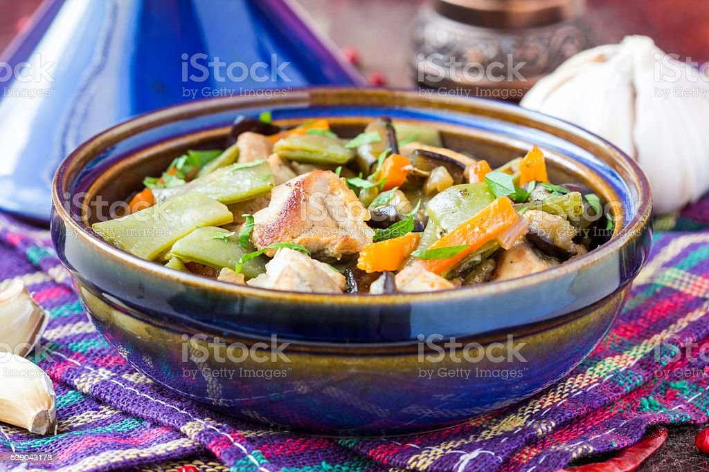 Oriental stew with meat, vegetables, green beans, carrot stock photo