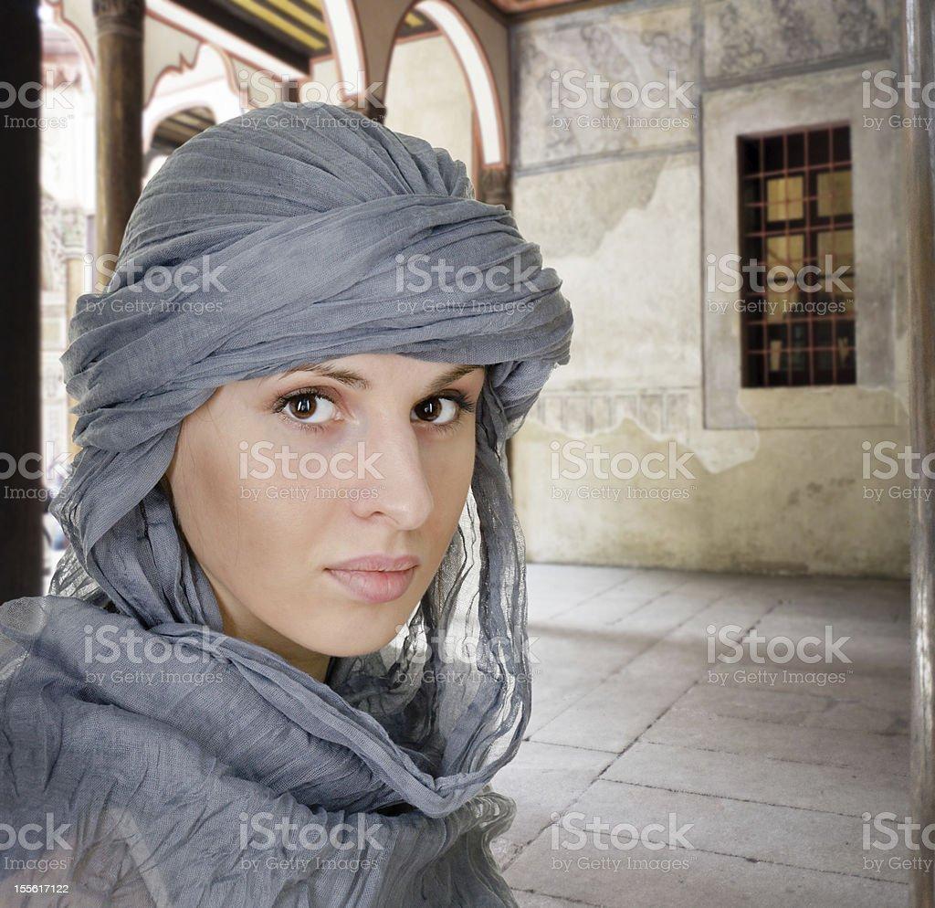 oriental style woman in shawl stock photo