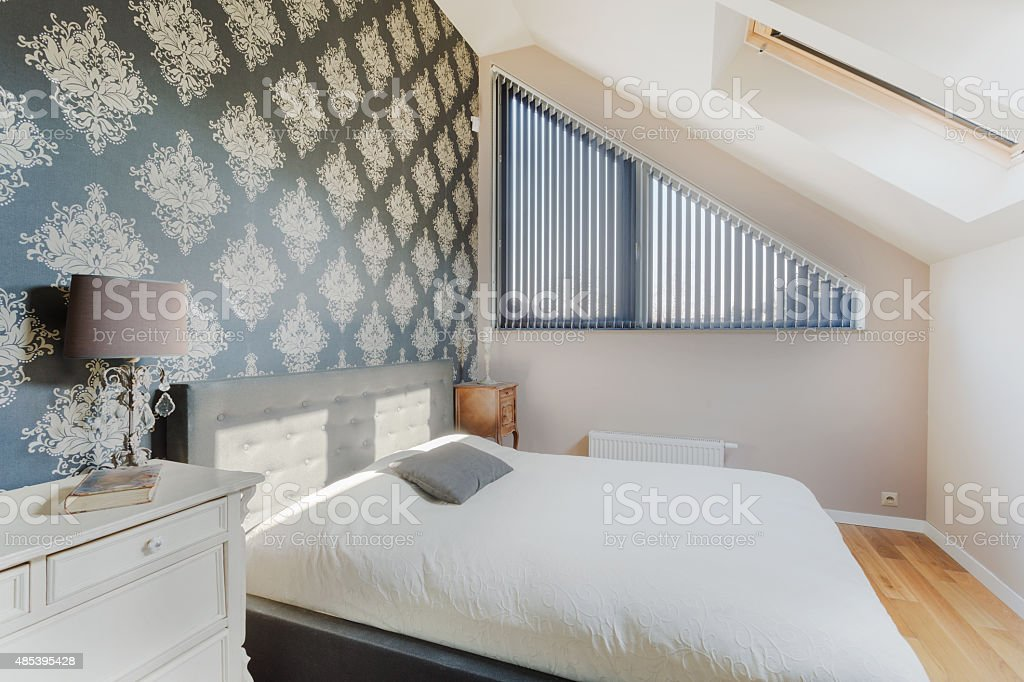 Oriental wallpaper in bedroom stock photo