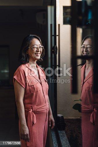 Oriental woman reflected in the glass window