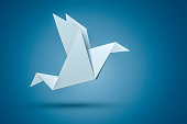 An image of an origami bird on a blue background