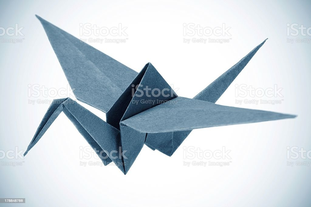 Origami crane isolated on a white background stock photo