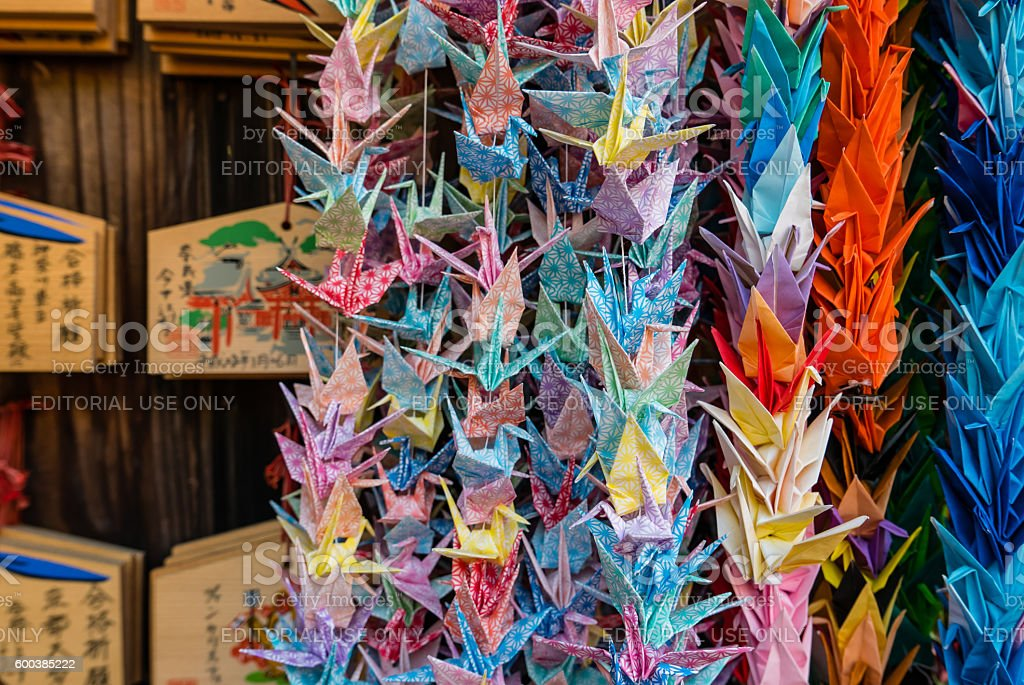 Origami cranes and prayer tablets stock photo
