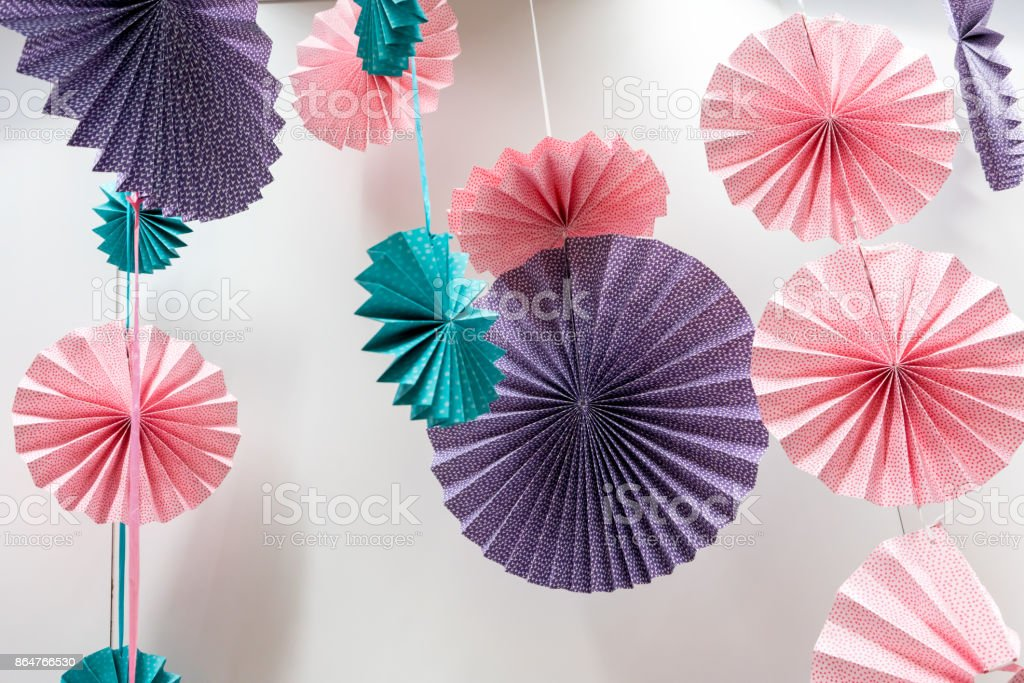 Origami Fans Wheel Paper Craft Folding And Hanging Against White