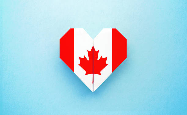 Origami Heart Textured with Canadian Flag on Turquoise Background Origami heart textured with  Canadian flag on turquoise background. Horizontal composition with copy space. Patriotism and Canada Day concept. canada day photos stock pictures, royalty-free photos & images