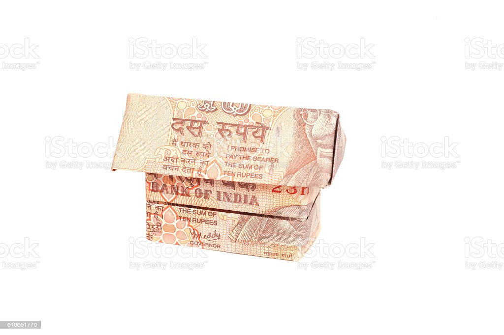 Origami Made of Indian rupee banknotes isolated on white background stock photo