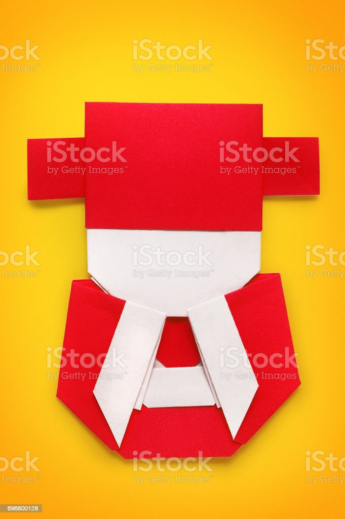 Origami Of Chinese God Of Wealth In Yellow Background Stock Photo