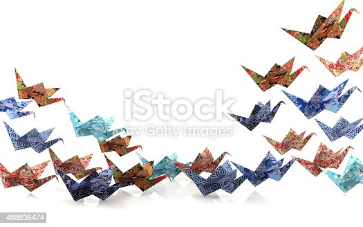 Group of Origami paper birds taking off, freedom concept