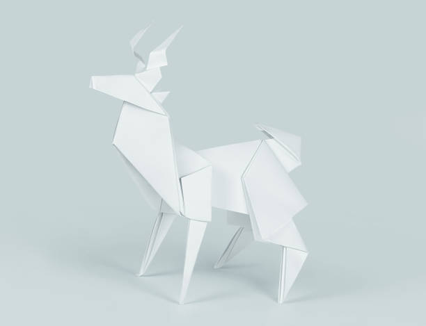 Origami paper deer isolated on blue backround stock photo