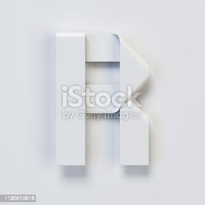 583978558istockphoto Origami paper font, folded ribbon font, letter R 1180610618