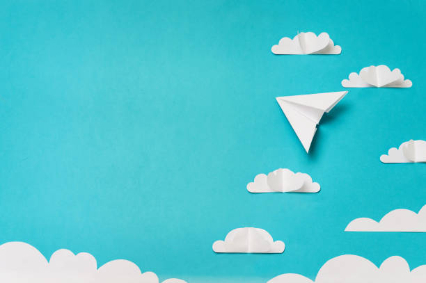 Origami paper plane in sky with clouds. Creative concept for banner/landing/background designs. stock photo