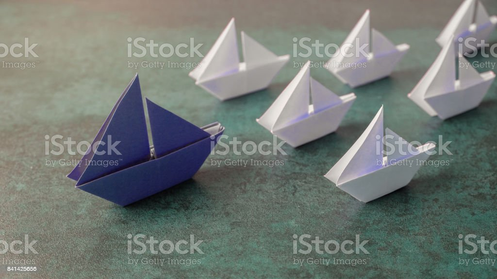 Origami paper sailboats, leadership business concept, toning, banner stock photo