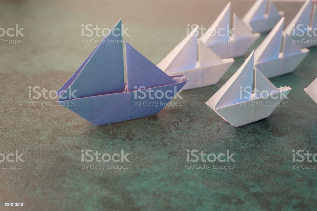 Origami paper sailboats, leadership business concept, toning stock photo