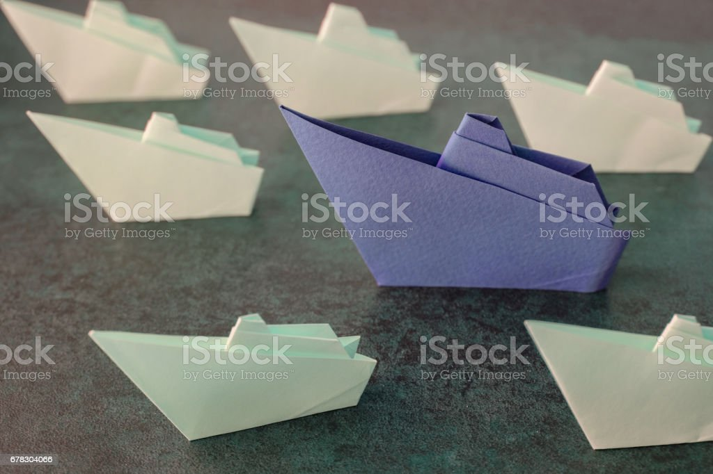 Origami paper ships, leadership concept, toning